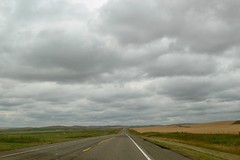 Straight down on the road in cloudy day (daveynin) Tags: plains grasslands cloudy road flat driving alberta canada