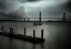 stormy weather... (HSS) (BillsExplorations) Tags: bridge stormy weather dark river boat pier arthurravenalbridge slide sliderssunday waters cooperriver charleston mtpleasant cablestayedbridge southcarolina silhouette historic shadow