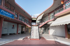 Belinda Awaits (Number Johnny 5) Tags: lines tamron d750 2470mm corfu storefront empty holiday stairs palm building steps angles subjectivelyobjective closed sky sidari deserted architecture perspective signs shops pale
