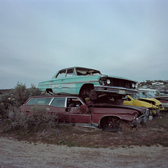 compact parking. 2015. (eyetwist) Tags: eyetwistkevinballuff eyetwist car auto ford galaxie film junkyard stacked idaho ishootfilm ishootkodak 6x6 analog mamiya 6mf 50mm kodak portra 160 mamiya6mf mamiya50mmf4l kodakportra160 analogue emulsion mamiya6 square 120 primes filmexif iconla epsonv750pro filmtagger americantypologies usa scrap junk decay derelict abandoned rust rusty rusted clouds overcast vintage classic horizon landscape barren bleak goat bumper chrome automobile green sedan parts parted galaxie500 stationwagon 1964 wheels