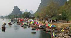 China - Li River Cruising (Mary Faith.) Tags: china river li guilin water tourist tourism unbrellas colourful landscape boats bamboo terraces misty