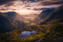 Beams (lonekheir) Tags: norge norway valley mountains rays beams river sun sunset pond water ocean sea