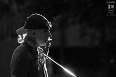 Mr. Tambourine Man ((explored)) (mkarwowski) Tags: m42 jupiter21m performer street man harmonica musician blackandwhite monochrome canon eos 1100d canoneos1100d eos1100d people białystok reflectyourworld