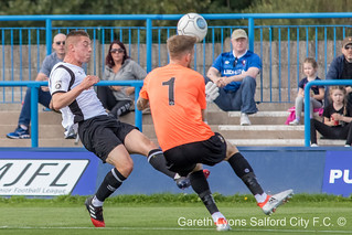 Josh Akew lifts the ball over Cameron Mason-3765