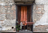 Balcony, Old Town, Cosenza (meg21210) Tags: cosenza oldtown balcony curtain chair clothesline clothespins orange orangecurtain wood doors wooddoors italy italia provinceofcosenza doubledoors weathered stucco apartment flat building architecture old