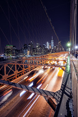 WALK ACROSS THE BROOKLYN BRIDGE (A B Pan) Tags: newyork brooklyn brooklynbridge night longexposure nyc manhattan taxis cars cartrails eastcoast