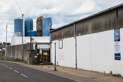 Malthouse Lane (Number Johnny 5) Tags: warehouse lines tamron d750 nikon streetlamp vertical storage lamppost drainpipe indusrial building post wires blue urban road angles subjectivelyobjective silo gorleston rusty deserted tarmac decay signs 2470mm riverside banal mundane