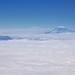 An Airplane Window View to Mount Rainier and Mount Saint Helens