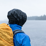 Hiker by a lake on a rainy day thumbnail