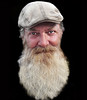 Far from the madding crowd ... (daystar297) Tags: streetportrait portrait availablelight homeless man beard closeup face people nikon nikond90 nikonnikkor18200vr