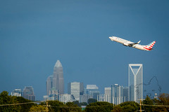 Over the skyline. (Lakeside Annie) Tags: 09292017 2017 20170929 55300mm airportoverlook cdia clt cpmg charlotte charlottedouglasinternationalairport charlottephotographymeetupgroup d7100 friday kclt leannefzaras nc nikkor55300mm nikon nikond7100 northcarolina sarazphotography september29 airport plane planes