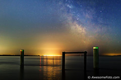 Milky Way with pier poles (james c. (vancouver bc)) Tags: green coast canada background dark richmond sea water landscape ocean garrypointpark britishcolumbia guidance nautical pacific sky northamerica adventure atmosphere star night astronomy starlight galaxy vast science outdoors infinite cluster space nature twinkle starry constellation stellar universe outerspace milkyway astro astrophotography starfield astrophotograph light tranquil pier pole wooden
