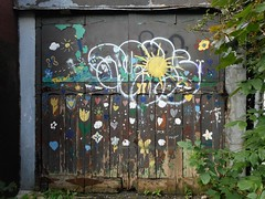 Sun through Cloud (navejo) Tags: montreal quebec canada door garage painting sun flowers alley