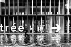 By going towards the exit (pascalcolin1) Tags: paris13 bnf homme man pluie rain reflets reflection sortie exit entrée entrance photoderue streetview urbanarte noiretblanc blackandwhite photopascalcolin