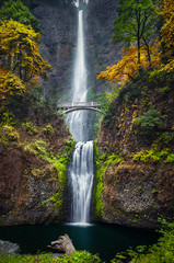 Multnomah Falls and Colors (Luís Henrique Boucault) Tags: bridge colorful colors green lake nature red river usa waterfall adventure america autumn beautiful beauty brown cliff color columbia exposure falls famous flowing foliage forest fresh gorge landscape leaves long lush motion multnomah natural northwest oregon park places rainforest scenery scenic smooth states stream travel trees united water waterfalls yellow
