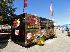 The Cheese Curd Shack Food Trailer. (dccradio) Tags: fayetteville nc northcarolina cumberlandcounty fair cumberlandcountyfair countyfair festival communityevent fun entertainment nikon coolpix l340 bridgecamera bigrockamusements amusement carnival midway mechanicalride thrillride ride rides amusementdevice attraction outside outdoors fairrides amusements amusementrides sky bluesky cheesecurds wisconsincheesecurds jalapeno redpepper friedcurds flag flags foodtrailer fairfood foodconcessions concessionstrailer tree trees greenery pavement mouse real cheese flowers