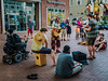 P1120848 Ragtag Band (Steve's Outtakes) Tags: band musicians wheelchair disabled hippies mall city urban downtown evening shops music concert troubadors