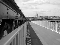 cycle path, - formerly a railway bridge. (chrisinplymouth) Tags: black white grayscale perspective bridge metal cycle cycling cyclepath laira princerock plymstock river plym plymouth devon england uk cw69x plymgrp lairabridge cyclists