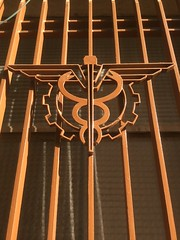 Caduceus..These representations feature the two snakes atop the staff (or rod), crossed to create a circle with the heads of the snakes resembling horns. (bernawy hugues kossi huo) Tags: hermes mercury alchemy serpent caduceus roman merchant protector gambler shepherd guide dead messenger metal window writing eloquence commerce negociation attribute asclepius healthcare medical symbol snacke stick baton kundalini ningishzida
