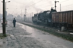 The Walk -  Zwickau DR   |  1986 (keithwilde152) Tags: br5035 zwickau sachsen dr ddr germany 1986 main station platforms tracks city people steam locomotives outdoor autumn rain