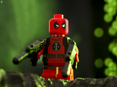 Mini Deadpool (jezbags) Tags: lego legos toys toystory minifigure minifigures macro macrophotography macrodreams macrolego canon60d canon 60d 100mm closeup upclose marvel marvelstudios legomarvel deadpool mini red guns green