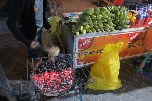 With friends in Kupang. Eating Kangkung Cah Bunga Pepaya (papaya flower), Nasi Se'i Babi  (Rice with smoked pork), bananas on the street and having some drinks at Pantai Koepan beach - 999 Resto & Bar, etc.  West Timor, Indonesia