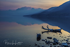A Quiet, Reflective Morning On Lake McDonald, Glacier National Park, Montana (rebeccalatsonphotography) Tags: sunrise morning lake reflection lakemcdonald westglacier glacier np nationalpark glaciernationalpark smoke haze forestfire spraguefire mountains rebeccalatsonphotography canon 5dsr