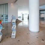 In main entrance hall, zig-zag racks are good design. :) ジグザグのパンフレット用ラックがいい感じ。なぜか関東の美術館の展示会のパンフばかり。