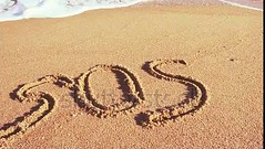 Video. For viewing of video follow the link.  Inscription on sand, the beach. The word the sos on sand. (daria.boteva) Tags: abstract aid background beach carved character coast communication concept conceptual danger design draw drawing font grain grunge handdrawn handwriting help holiday idea inscription letter message natural nature nobody ocean outdoors rescue sand scratched sea shore sign sos stick style summer symbol text texture textured typescript water wave word write