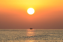 Early one gets the best catch... (Aleem Yousaf) Tags: sunrise sousse tunisia reflection glow fishermen boat seascape serene silhouette sea water gulf hammamet mediterranean berber early start north africa best catch beach ocean dawn golden hour