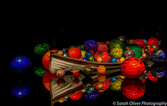 That boat is full of balls! (SarahO44) Tags: america seatle states united usa washington chihuly garden glass space needle center balls boat full indoors bright colours reflection spheres wooden art sculpture exhibit