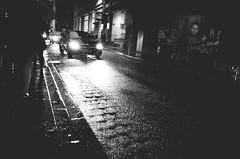 Headlight Reflections (Jon Cartledge) Tags: people black blackandwhite bw car gr headlights iconic life lights melbourne melbs mono monochrome photography photos pointandshoot rain relfection ricoh ricohgr shot snap streetphotography streetscene streetshooter streetshot streetview streets tourists travel urbanpeople urbanstreet urbanview whitebw
