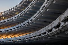 Arcs (pi3rreo) Tags: lignes urbain urban extérieur city ville noisy france paris fujinon fujifilm light orange lumière parking béton denis seine architecture arcades poetry poésie sunset coucher soleil