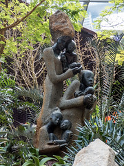 Multiple Maternity (Steve Taylor (Photography)) Tags: multiplematernity art sculpture carving statue window brown green smile smiling stone rock child kid woman women asia singapore leaves succulent texture african flowerdome gardensbythebay hapungusculpturemovement springstone zimbabwe cradling cuddling