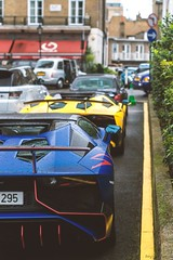 2x Wet SV (Beyond Speed) Tags: carbon yellow blue rain wet knightsbridge london v12 combo automotive automobile automobili auto carspotting cars car supercars supercar roadster superveloce sv aventador lamborghini