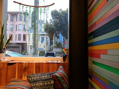 early morning coffee at pinhole (Liz Henry) Tags: cameraphone pinhole coffee rainbow beachglass window bernal