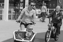 Wrong way (Martijn A) Tags: bicycle fiets biking fietsen candid people mensen woman vrouw child kind scheveningen thehague denhaag sgravenhage 070 streetphotography straatfotografie canon77deos canon70200mmf4lis wwwgevoeligeplatennl crying huilen sit sitting seated
