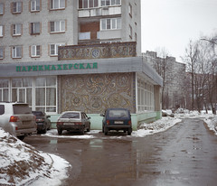 Moscow, feb 2016 (urban.photo.lv) Tags: moscow winter suburbs living blocks flat residential buildings district niva lada cars carpet wall decoration shop analog film fuji gw 670 ii kodak portra vuescan road snow dirt