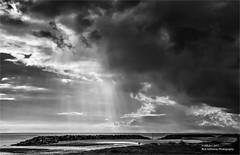 Weather contrast (rhfo2o - rick hathaway photography) Tags: rhfo2o canon canoneos7d elmer elmersands bognorregis westsussex beach sea seaside sand sky sun clouds sunshine godsfingers rays bw blackandwhite mono seascape landscape