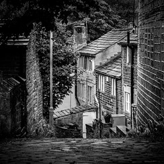 Honley cobbles (Matthew Brown 7) Tags: bw cobbles landscape honley nikon d750 nikon85mmf18g f8 cottages trees street steep wet slippery ruby3