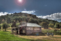 The Blacksmith [EXPLORED] (Spebak) Tags: spebak canon canondslr canon70d california southerncalifornia lensflare solarflare 20mmlens outdoors building buildingexterior mountains field landscape blacksmith oldwest west western