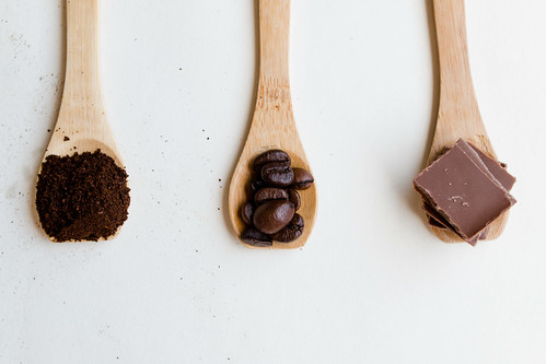 Top View of Wooden Spoons with chocolate and coffee beans