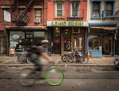 Sushi To Go (Darren LoPrinzi) Tags: 5d canon5d manhattan ny nyc newyork newyorkcity urban canon city miii soho sushi sohosushi biker cyclist motion motionblur lowermanhattan downtpwn bicycle restaurant store stores storefront storefronts noho greenwichvillage village man