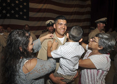 Chief Gunners Mate John Zuniga is frocked by family members.