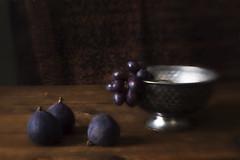 Still Life with Three Figs (suzanne~) Tags: stilllife tabletop fruit fig bowl silverbowl dark painterly lenbaby plasticoptic lowkey grape