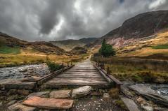 The leading path ......Watkin. Snowdonia (Einir Wyn Leigh) Tags: landscape wales path snowdon cymru moody sky bridge rain outdoors contrast dark weather walking nikon colorful trek light clouds black
