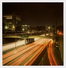Grand Ave Second Right (tobysx70) Tags: the impossible project tip polaroid sx70sonar sonar instant color film for sx70 type cameras impossaroid grand ave second right 101 hollywood freeway los angeles street bridge dtla downtown la california ca exit sign night nocturnal headlight taillight lighttrails red white bokeh us101 el camino real vanishing point toby hancock photography
