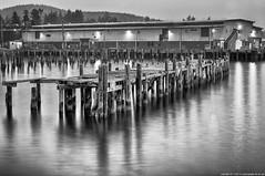 2017-08-02 Abandoned Standard Oil Co. Dock (B&W) (Long Exposure) (2048x1360) (-jon) Tags: anacortes skagitcounty skagit washingtonstate washington salishsea fidalgoisland sanjuanislands guemeschannel tridentseafoods longexposure blackandwhite bw monochrome timestack composite standardoil water abandoned pier dock a266122photographyproduction derelict forgotten neglected ruins night reflection