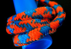 STAYING HEALTHY by SKIPPING...Macro Mondays (Lani Elliott) Tags: macro upclose close closeup bright color colourful colour orange blue blackbackground macrounlimited skippingrope rope stayinghealthy macromondays superb fantastic excellent beautiful brilliant wow gorgeous