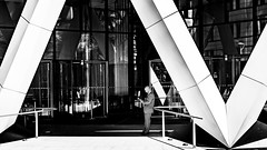 Underneath The Arches (Sean Batten) Tags: london england unitedkingdom gb blackandwhite bw streetphotography street candid person people thegherkin 30stmaryaxe light shadow city urban nikon df 58mm